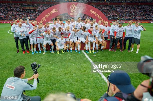 Poland's players celebrate their qualification after their Euro 2020 qualifier Group G football match Poland v Macedonia in Warsaw Poland on October...