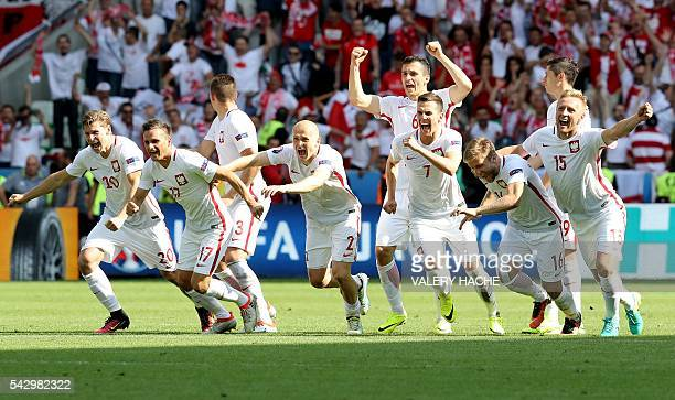 TOPSHOT Poland's players celebrate their team's win in the Euro 2016 round of sixteen football match between Switzerland and Poland at the...