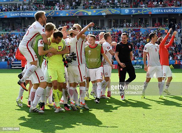 Poland's players celebrate their team's win in the Euro 2016 round of sixteen football match between Switzerland and Poland at the GeoffroyGuichard...