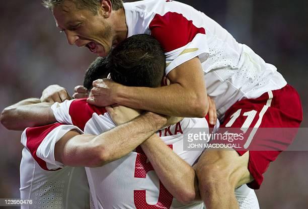 Poland's players including defender Dariusz Dudka and midfielder Rafal Murawski celebrate scoring during the International friendly football match...