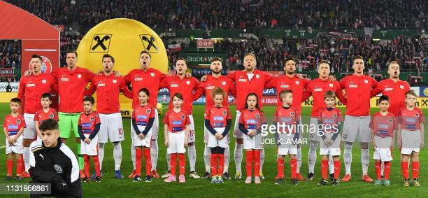 Poland's players listen to the Polish national anthem before the Euro 2020 football qualification group G match between Austria and Poland at Ernst...