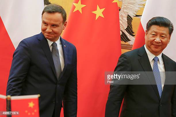 Poland's President Andrzej Duda and his Chinese counterpart Xi Jinping leave the podium after a signing ceremony following their meeting at the Great...