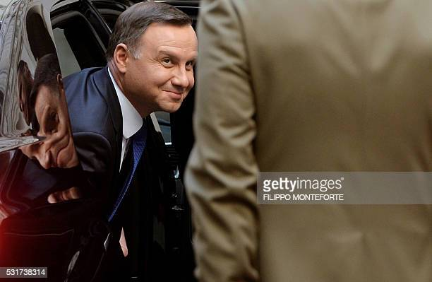 Poland's President Andrzej Duda exits his car as he arrives for a meeting with Italy's prime minister at the Chigi Palace in Rome on May 16, 2016. /...