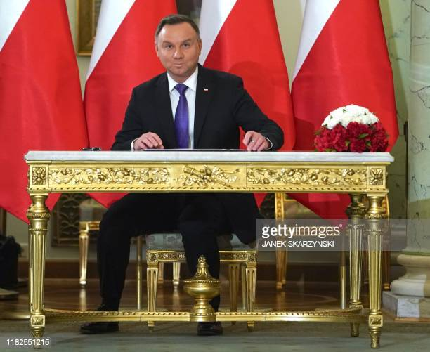 Poland's President Andrzej Duda signs the document of appointment for incoming prime minister Mateusz Morawiecki of the Law and Justice , at the...
