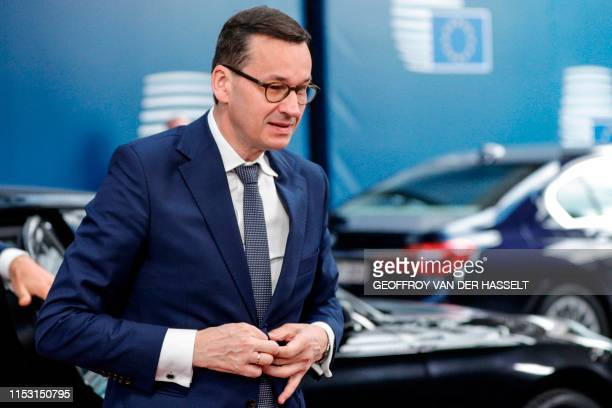 Poland's Prime Minister Mateusz Morawiecki arrives for the third straight day of an European Union leaders summit in Brussels on July 2 for talks...