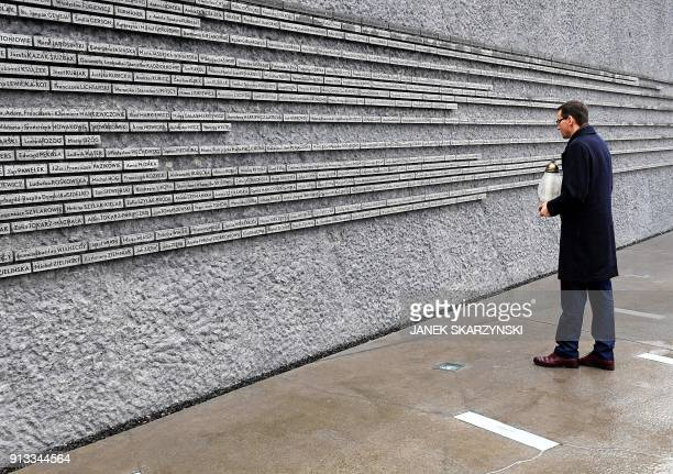 Polands Prime Minister Mateusz Morawiecki arrives on January 2 2018 outside the Ulma Family Museum that is documenting the fate of the Polish Ulma...