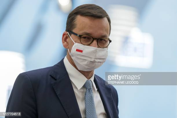Poland's Prime Minister Mateusz Morawiecki wearing a protective face mask arrives for the fourth day of an EU summit at the European Council building...