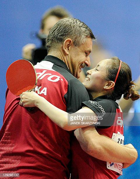 Poland's Qian Li celebrates with her coach Zbigniew Necekafter winning against German's Zhenqi Barthel at the end of their European Table Tennis...
