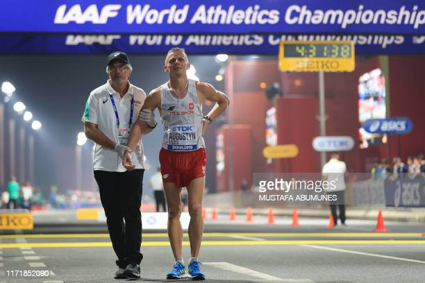 Poland's Rafal Augustyn receives medical attention in the Men's 50km Race Walk final at the 2019 IAAF World Athletics Championships in Doha on...