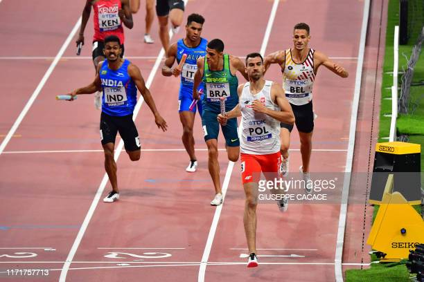Poland's Rafal Omelko crosses the finish line to win the Mixed 4 x 400m Relay heats at the 2019 IAAF World Athletics Championships at the Khalifa...
