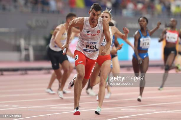 Poland's Rafal Omelko receives the baton from teammate Malgorzata HolubKowalik in the Mixed 4 x 400m Relay heats at the 2019 IAAF World Athletics...