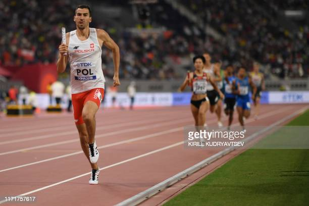 Poland's Rafal Omelko runs to win the Mixed 4 x 400m Relay heats at the 2019 IAAF World Athletics Championships at the Khalifa International stadium...