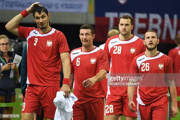 Poland's right back Krzysztof Lijewski Poland's centre back Przemyslaw Krajewski Poland's left back Mariusz Jurkiewicz and Poland's right wing Michal...