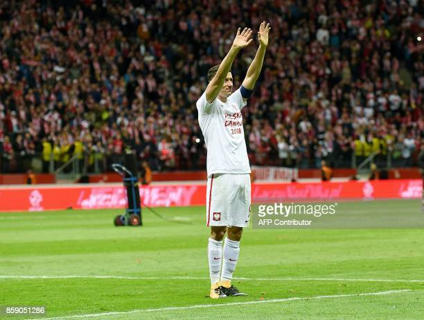 Poland's Robert Lewandowski greets supporters after Poland won 42 the FIFA World Cup 2018 qualification football match between Poland and Montenegro...