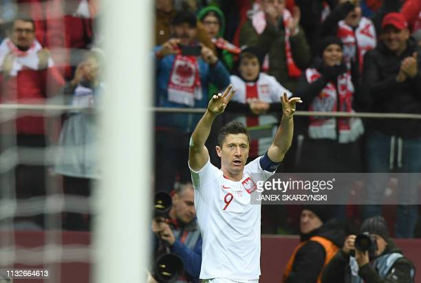 Poland's Robert Lewandowski reacts after he scoored a goal during the UEFA Euro 2020 Group B qualification football match between Latvia and Poland...