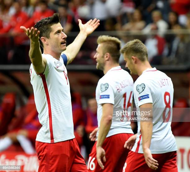 Poland's Robert Lewandowski reacts after he scored a goal during the FIFA World Cup 2018 qualification football match between Poland and Romania in...