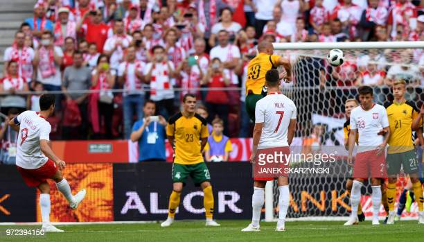 Poland's Robert Lewandowski scores a goal during the international friendly football match between Poland and Lithuania in Warsaw Poland on June 12...