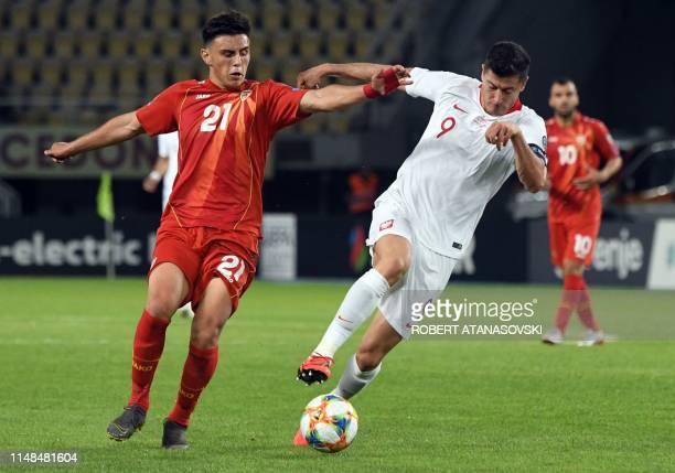 Poland's Robert lewandowski vies with North Macedonia's Eljif Elmas during the UEFA Euro 2020 qualifying football match between North Macedonia and...