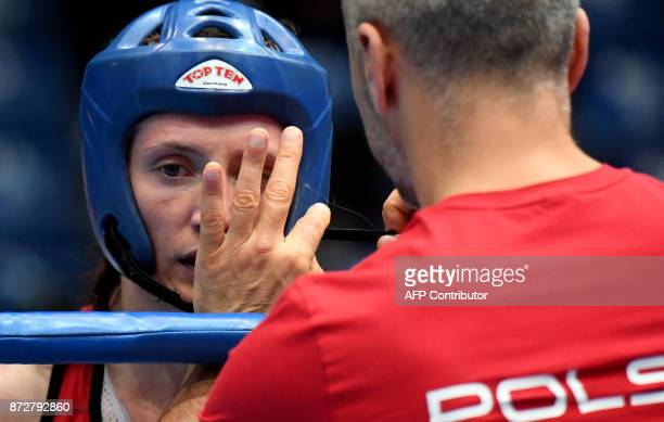 Poland's Roza Gumienna listens to her coach during her fight against Netherlands' Sarel de Jong in the 'Women K1 48kg category' in the 'BOK' sports...