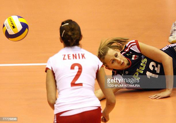 Poland's setter Milena Sadurek fails to receive the ball as her teammate Mariola Zenik looks on during their FIVB Women's World Cup second round...