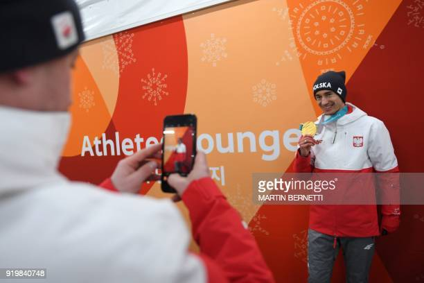 Poland's ski jumper and gold medallist Kamil Stoch poses for a picture backstage at the Athletes' Lounge during the medal ceremonies at the...