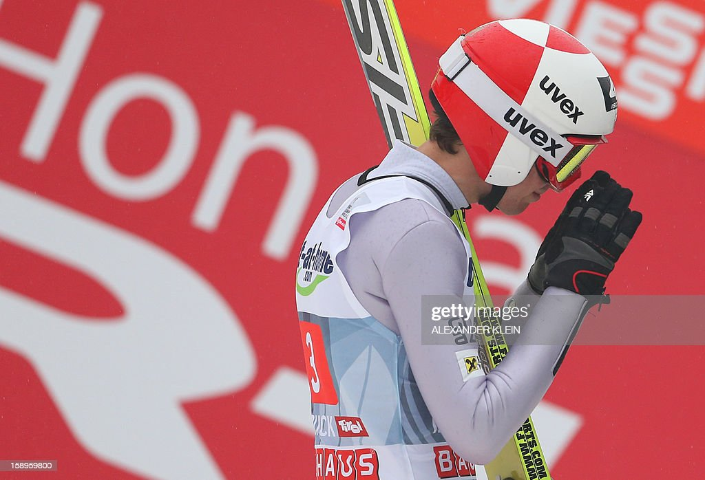 Poland's ski jumper Kamil Stoch gestures during the 61st Four-Hills-Tournament (Vierschanzentournee) in Innsbruck, Austria on January 4, 2013. Austria's Schlierenzauer won ahead of Poland's Kamil Stoch and Norway's Anders Bardal.