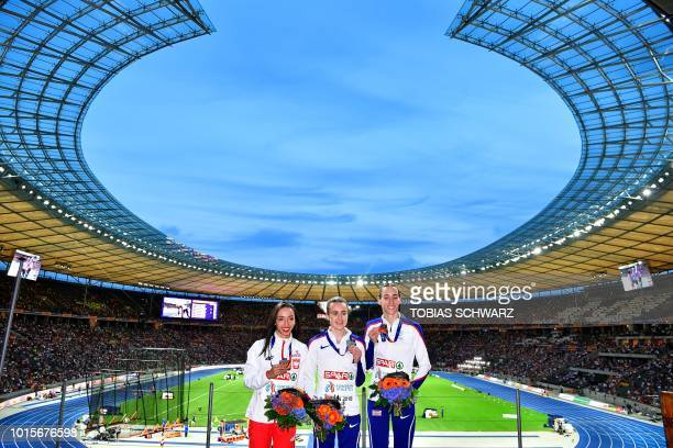 Poland's Sofia Ennaoui, Great Britain's Laura Muir and Great Britain's Laura Weightman celebrate on the podium during the medal ceremony for the...