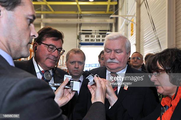 Poland's Solidarity the trade union's iconic founding father and former Polish leader Lech Walesa flanked by the CEO of the Groupe Liebot Andre...
