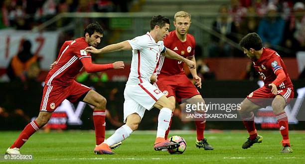 Poland's striker Robert Lewandowski and Armenia's Karen Muradyan Varazdat Haroyan and Artak Grigoryan vie for the ball during the WC 2018 football...