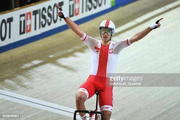 Poland's Szymon Sajnok celebrates as he wins the men's omnium final during the UCI Track Cycling World Championships in Apeldoorn on March 3 2018 /...