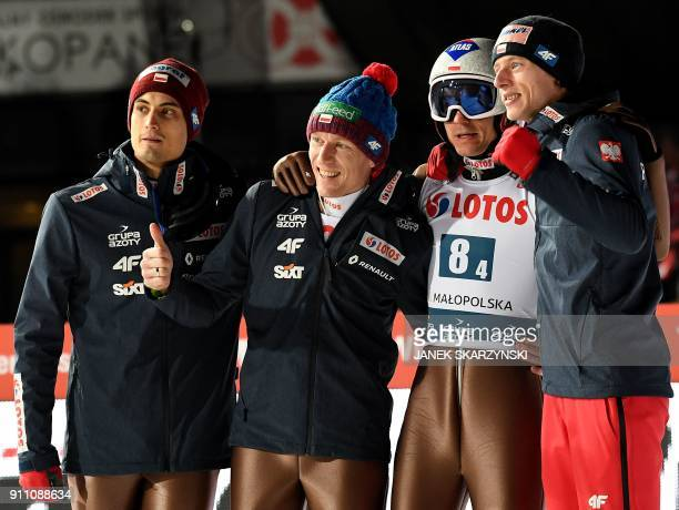 Poland's team Maciej Kot Stefan Hula Kamil Stoch and Dawid Kubacki celebrate after winning the team competition of the FIS Ski Jumping World Cup in...