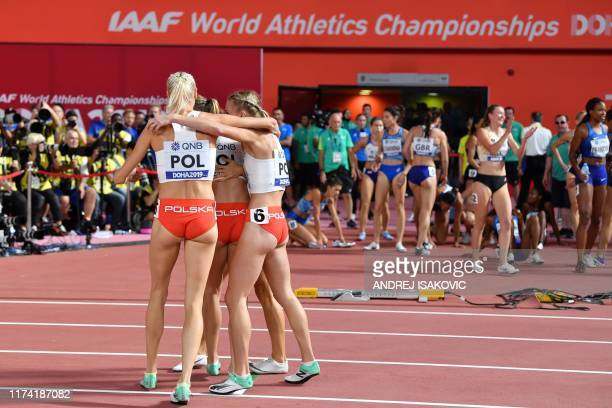 Poland's team reacts after finishing second in the Women's 4x400m Relay final at the 2019 IAAF Athletics World Championships at the Khalifa...
