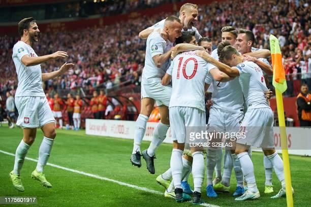 Poland's teammates celebrate the opening goal by Poland's midfielder Przemyslaw Frankowski during the Euro 2020 qualifier Group G football match...