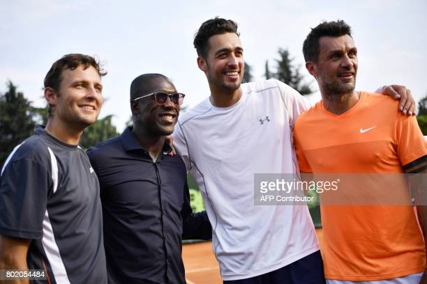 Poland's Tomasz Bednarek AC Milan's former player Clarence Seedor Nederland's David Pel and AC Milan's former player Paolo Maldini pose after a men's...