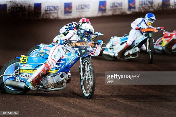 Poland's Tomasz Gollob and Jaroslaw Hampel compete during the FIM Scandinavian Speedway Grand Prix in Malilla southern Sweden on September 8 2012 AFP...