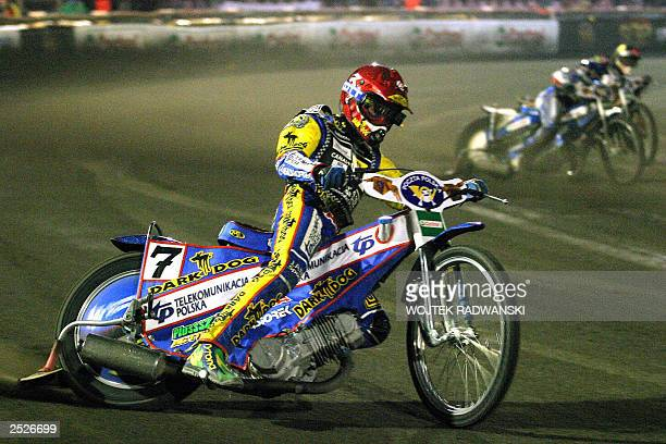 Poland's Tomasz Gollob takes a curve during a Speedway Grand Prix Competitions race in Bydgoszcz 20 September 2003 Gollob won the event AFP PHOTO...