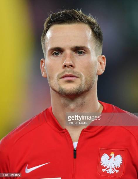 Poland's Tomasz Kedziora listens to the Polish national anthem before the Euro 2020 football qualification group G match between Austria and Poland...