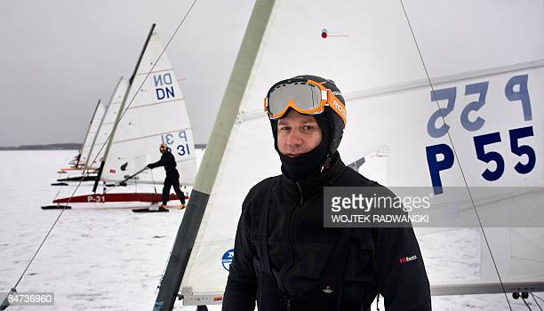 'Polandsportsextremesail' DN class type Iceboat skipper Tomasz Zakrzewski is seen warming up before a local competition on the frozen lake Sniardwy...