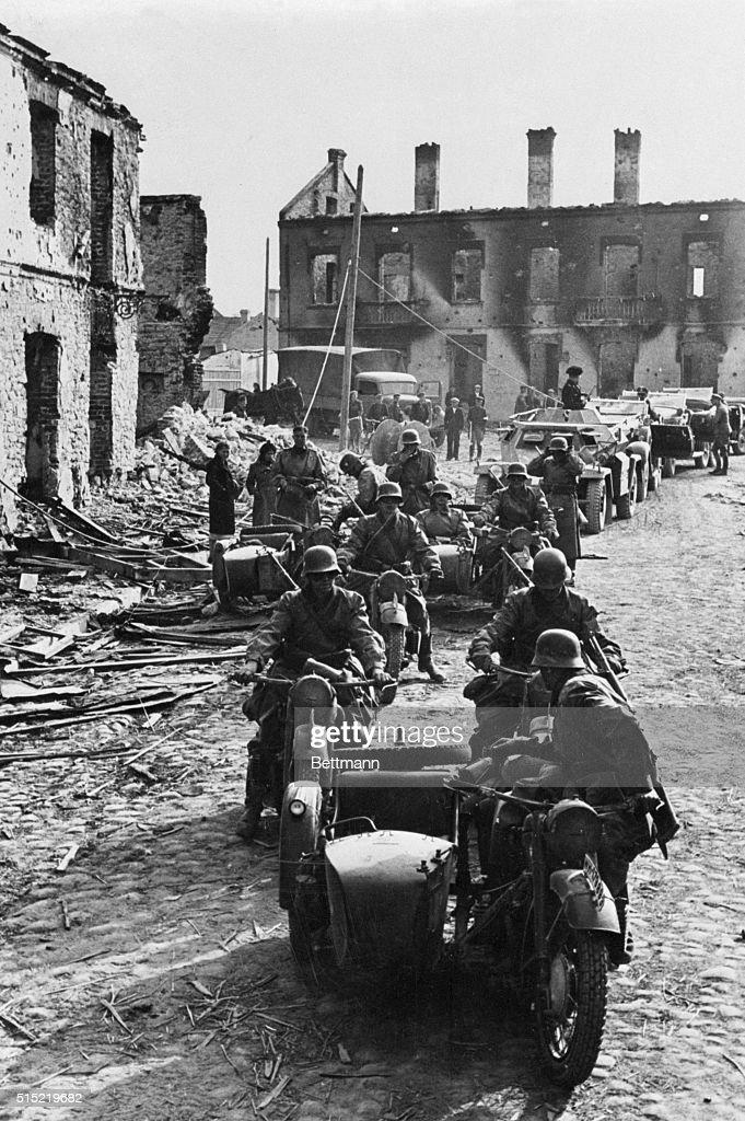 German Army Riding on Motorbikes Through Polish Town : News Photo