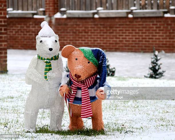 Polar bear and teddy bear holiday decorations are still outside after a late January snowstorm.