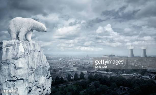 polar bear overlooking cityscape from glacier - cooling tower stock pictures, royalty-free photos & images