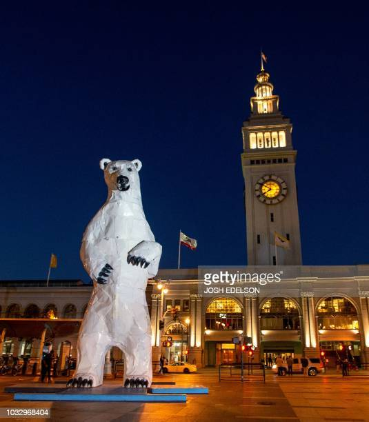 A polar bear statue made out of car hoods is seen in front of the Ferry Building during the Global Climate Action Summit in San Francisco California...