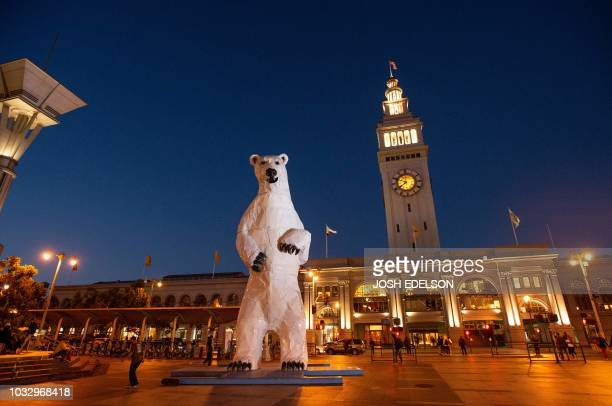 TOPSHOT A polar bear statue made out of car hoods is seen in front of the Ferry Building during the Global Climate Action Summit in San Francisco...