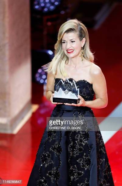 Polar Music award winner German violinist Anne-Sophie Mutter poses with her award during the price ceremony at the Grand Hotel in Stockholm on June...