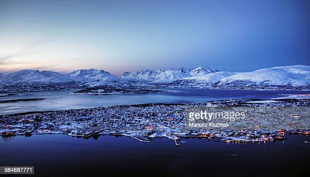 Polar night in Tromso and snow covered mountains