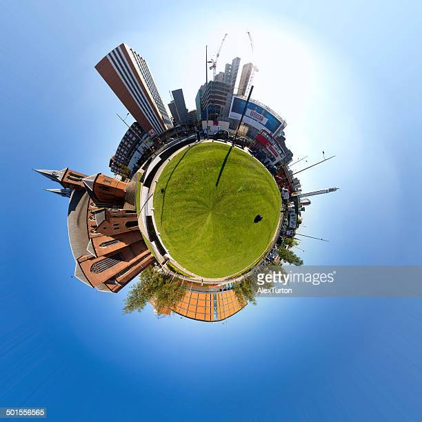 Polar planet in an urban setting with grass