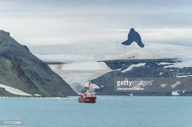 Polar ship Ary Rongel at anchor in Admiralty Bay with the Nunatak Needle in the background, on January 12, 2020 in King George Island, Antarctica.