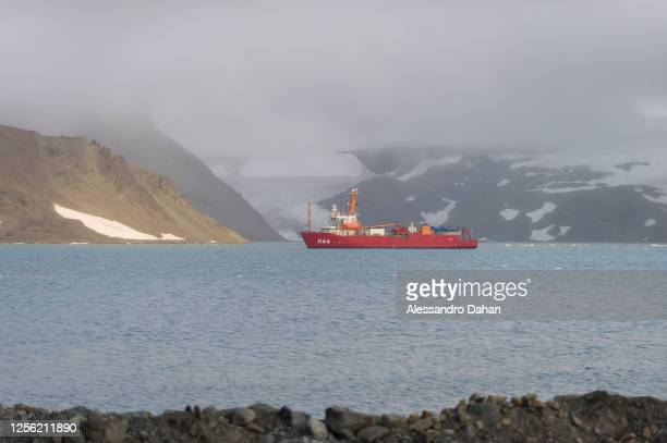 Polar ship Ary Rongel docking at the bottom of Admiralty Bay with sunlight illuminating the mountain, on January 06, 2020 in King George Island,...
