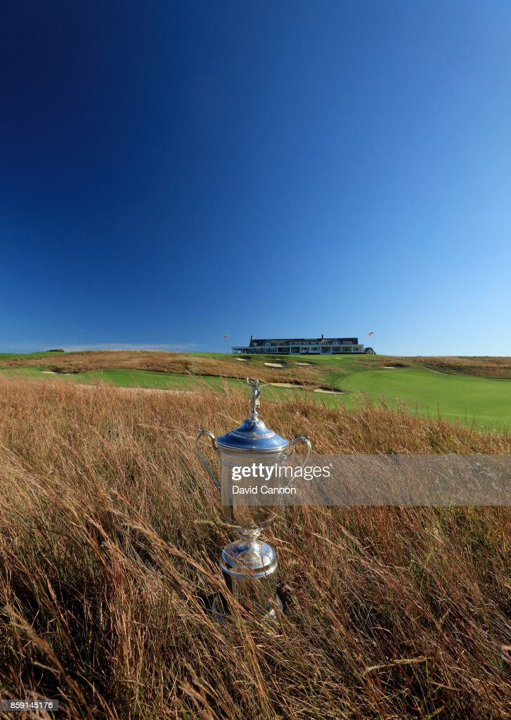 Polarising filter used on the camera in this image; The United States Open trophy placed in the long grass beside the 18th hole at Shinnecock Hills Golf Club the host venue for the 2018 US Open Championship on October 4, 2017 in Southampton, New York.