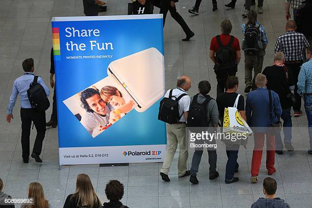 A Polaroid advertisement stands on the show floor during the Photokina photography trade fair in Cologne Germany on Tuesday Sept 20 2016 Photokina...
